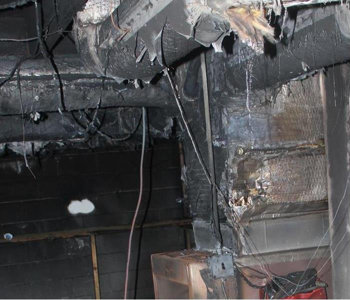 severely damaged/blackened HVAC system and ducts