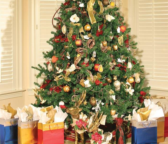 Beautifully decorated Christmas tree with presents under it